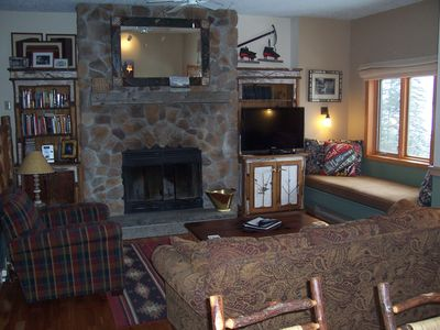 Our very cozy living room area, with TV and wood fireplace, books and games too!
