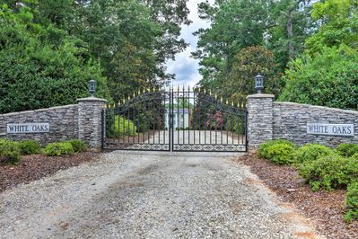 A gated, long driveway lined with over 20 magnolias welcomes you to this estate.