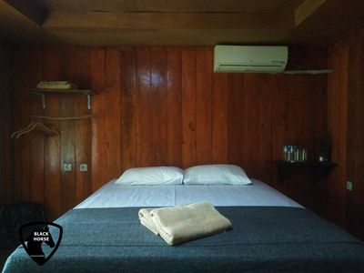 Photo for Black Horse / 1BR/ AC/WIFI/woodenbungalow/GiliMeno