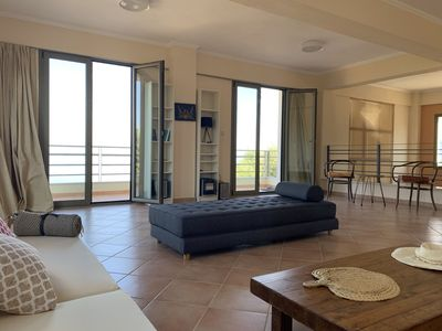 The main living area, features a relaxing environment with balconies and views.