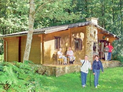 Photo for Cozy, wooden chalet with a microwave, located in a forest