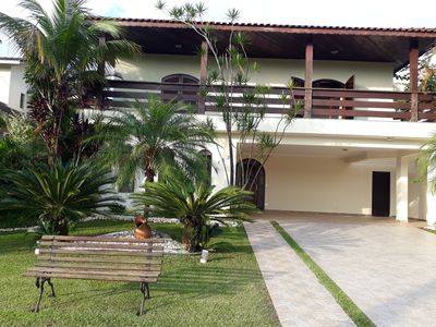 Photo for HOUSE OF HIGH STANDARD IN THE CONDOMINIUM ACAPULCO GARDEN. 4 SUITES. GUARUJÁ.