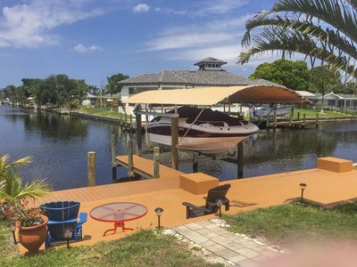 Photo for Beautiful Waterviews, Tranquil Sunsets,Salt Water Pool, Yacht Club Area