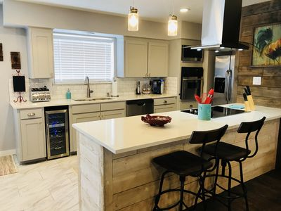Kitchen includes full size appliances along with a wine fridge.