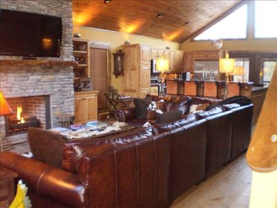 GREAT ROOM WITH HUGE ROCK FIREPLACE, 20' LEATHER SECTIONAL AND 55' FLAT PANEL