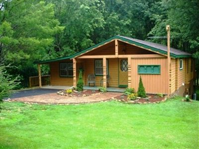 Photo for ON THE RIVER is what you will be when you stay at Cozy River Cabin. Located in the heart of Valle Crucis just minutes to Mast General Store, Candy Barrel and Valle Crucis Park. Don't let the subdued exterior fool you.