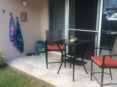 Relax on your end-unit lanai