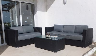 relax and soak up the sun on the patio sofas