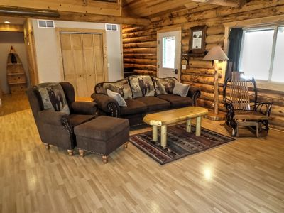 Living room feels rustic with log cabin decor & 'branch' rocking chair