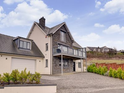 Photo for This spacious, comfortable and well-equipped detached property sits in an elevated coastal village l