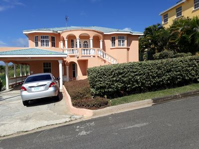 Front view of property with rental car
