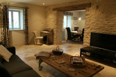 Open plan living room, through to dining and kitchen, House One