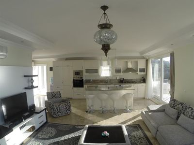 Open plan kitchen with bar area