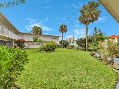 Photo for Inviting garden view condo w/full kitchen and free WiFi! Just 1 block to beach