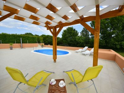 Photo for This 2-bedroom villa for up to 4 guests is located in Novigrad and has a private swimming pool and a