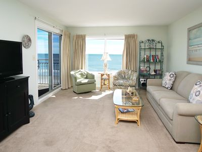 Photo for RELAX IN THE BEACHSIDE POOL, lounge on the sundeck, and enjoy a pleasant day on the beach.