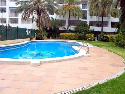 Photo for Apartment in building with large garden area and salt water pool, located in a quiet area