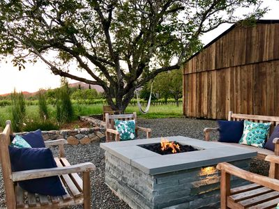 Sunset evenings in comfort at fire pit with view of barn & neighboring vineyards