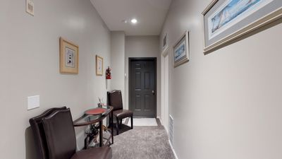 Common area with washer and dryer to the door on your right.