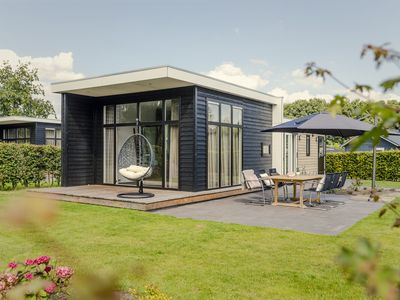 Photo for Beautiful, modern chalet right on the water, located in a cheery holiday park