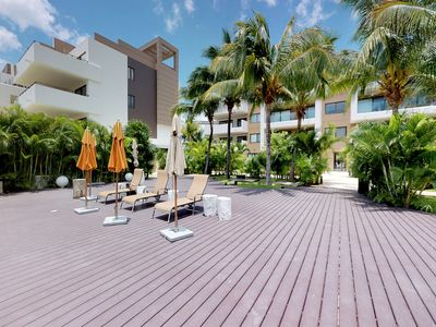 Photo for NEW LISTING! Sleek, modern condo w/ shared pool - near beach and golf