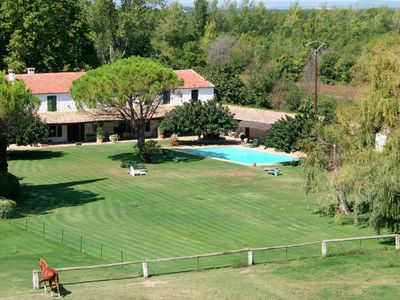 Photo for Stylish holiday home for 8 people in the Camargue, with shared swimming pool.