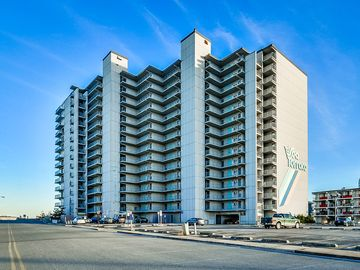 Spacious, comfy 2 bedroom oceanfront condo with free WiFi, an outdoor pool, and a pretty ocean view located uptown just steps to the beach!