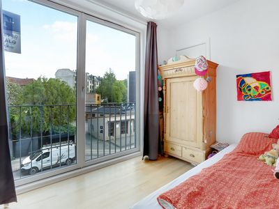 Photo for Modern apartment in lively neighborhood near shopping and public transport