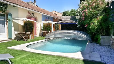 Photo for Charming cottage with jacuzzi and swimming pool in the village of Vacqueyras