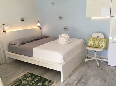 Super comfortable Queen-size bed with ambient lighting