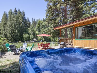 Photo for RIVERFRONT!  RIVERS EDGE, Private Hot Tub, Free WIFI and Sat. Pet Friendly!