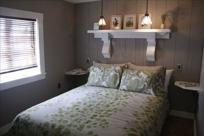 Bedroom/queen size bed, lots of pillows/quality bedding/personalized lighting.