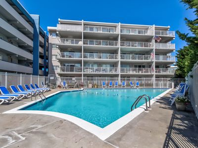 Photo for Elegant condo w/ private deck and seasonal pool/hot tub - walk to beach!