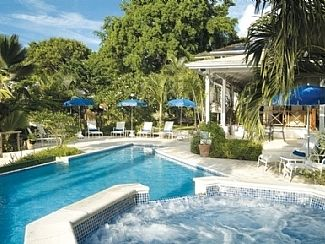 Heated jacuzzi flowing to pool and large sunbathing deck with loungers/umbrellas