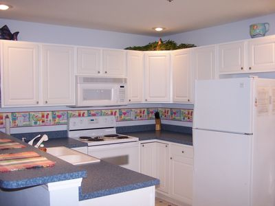 The convenience of a full kitchen makes it easy to prepare meals.