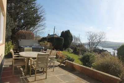 Front terrace with dining area and hot tub with view across Fishguard Bay