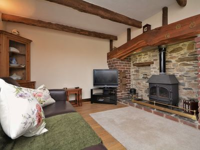 Cosy and welcoming lounge with gas effect woodburner