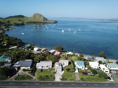 Photo for Iconic Kiwi Bach, magical Sea and Bush views