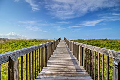 Take the boardwalk down to the beach from this vacation rental!