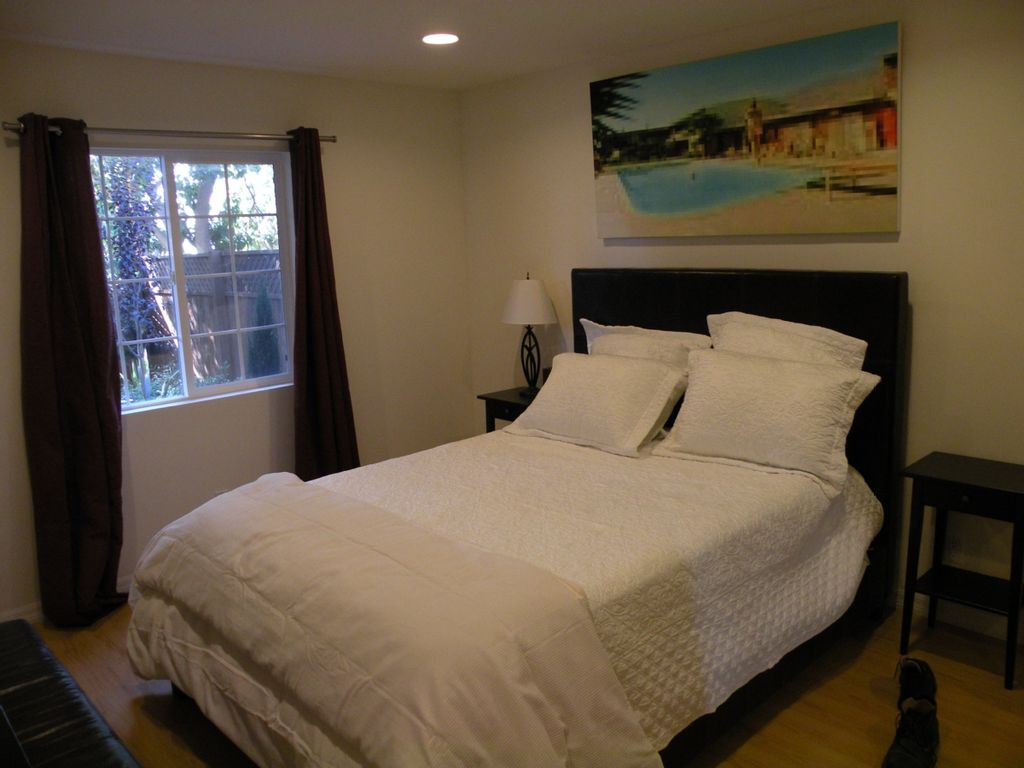 Bedroom  t v  and writing desk opposite bed. Sunset Hollywood Bungalow  Walk to Everywhere      HomeAway