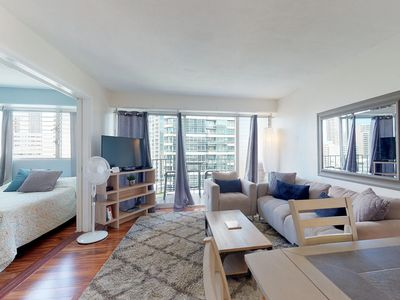 Photo for NEW LISTING! Bright walkable condo in Waikiki w/ shared pool, free Wifi & views!