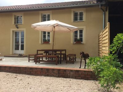 The sunny terrace with outdoor dining
