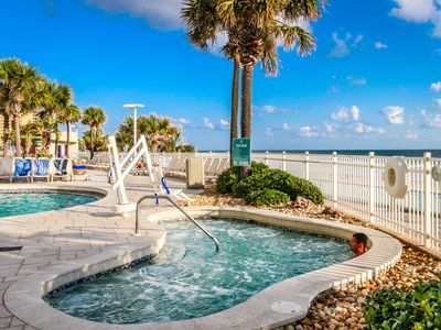 Photo for Ocean front condo with 4 shared pools, lazy river, fitness room & more!