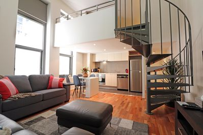 Relax downstairs then head up the spiral staircase to your Loft Bedroom.