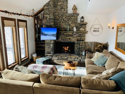 Our Cozy main living room with fireplace & views.