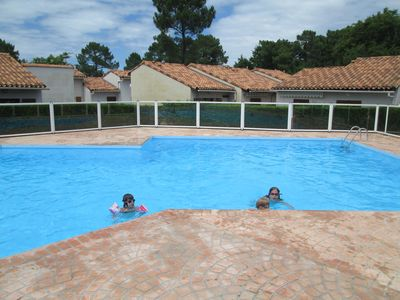Photo for Maisonette shaded garden in residence with pool ideal couple and 2 children