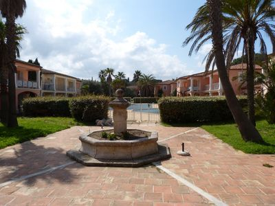 Photo for Apartment in secure residence, quiet with pool near the village of Grimaud