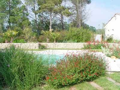 Photo for Stunning villa in a landscaped garden with pool