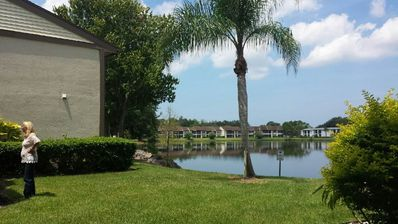 Photo for family friendly, gated community, two pools, lake outside back door.