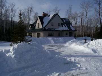 4 Bedroom Ski Home. Cozy custom solar home with radiant heat, fireplace, hot tub